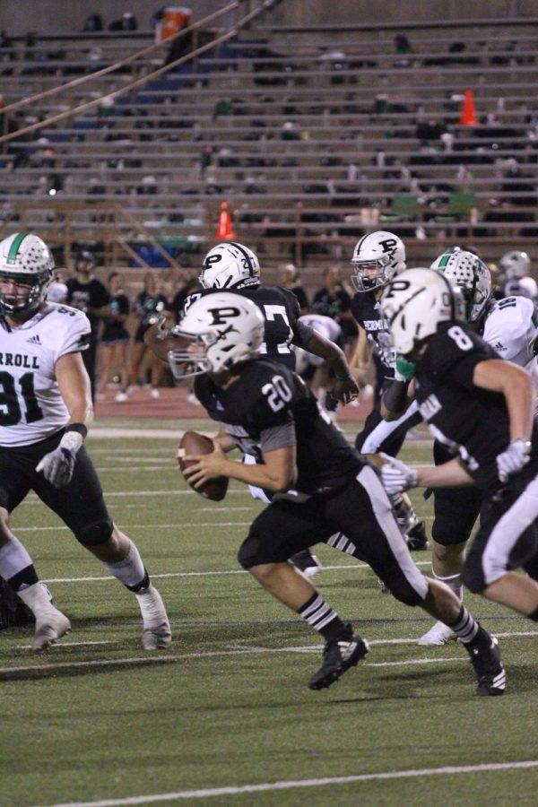 Quarterback+senior+Harper+Terry+runs+for+out-of-bounds+to+gain+a+few+yards+against+Southlake+Carroll.