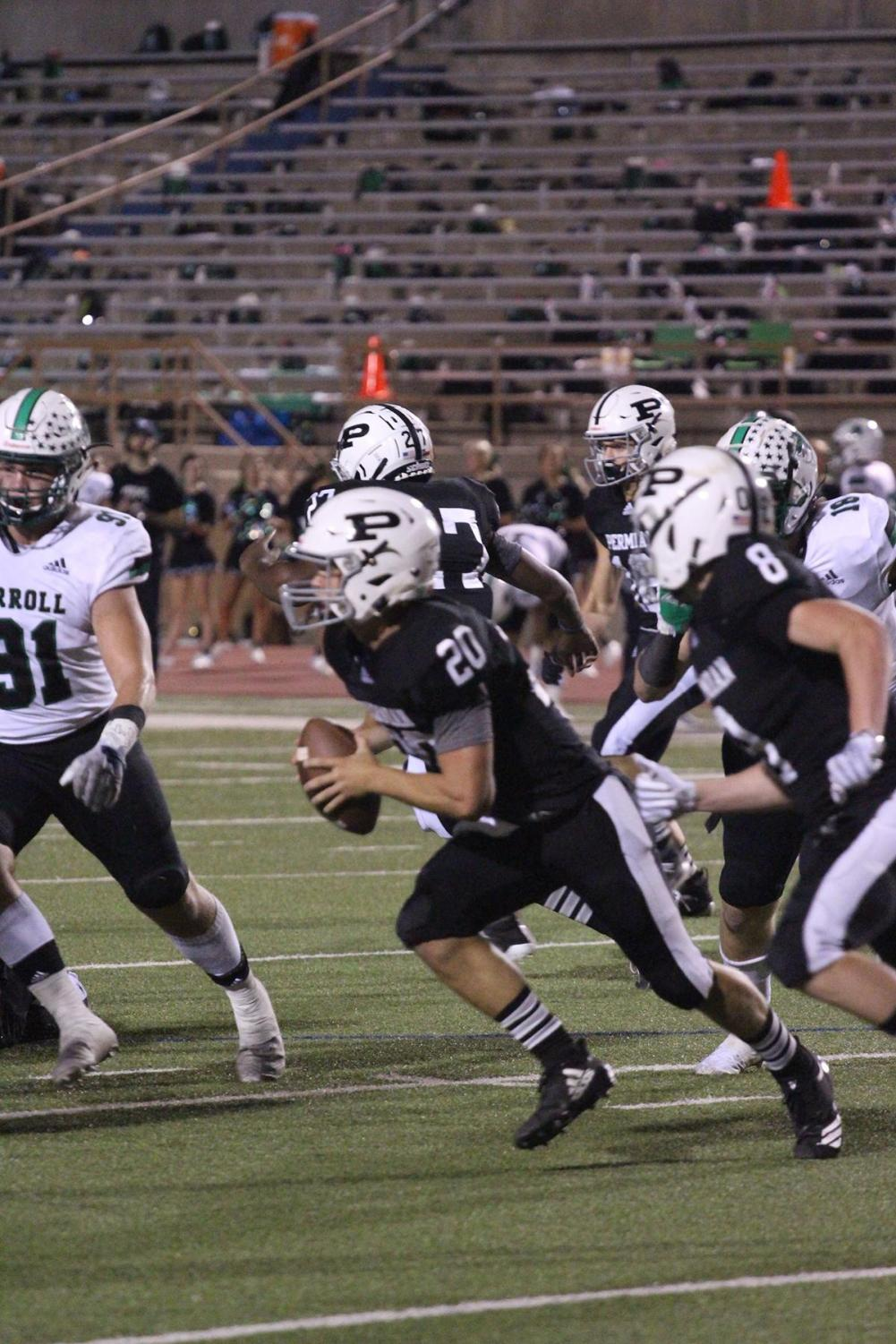 Quarterback senior Harper Terry runs for out-of-bounds to gain a few yards against Southlake Carroll.