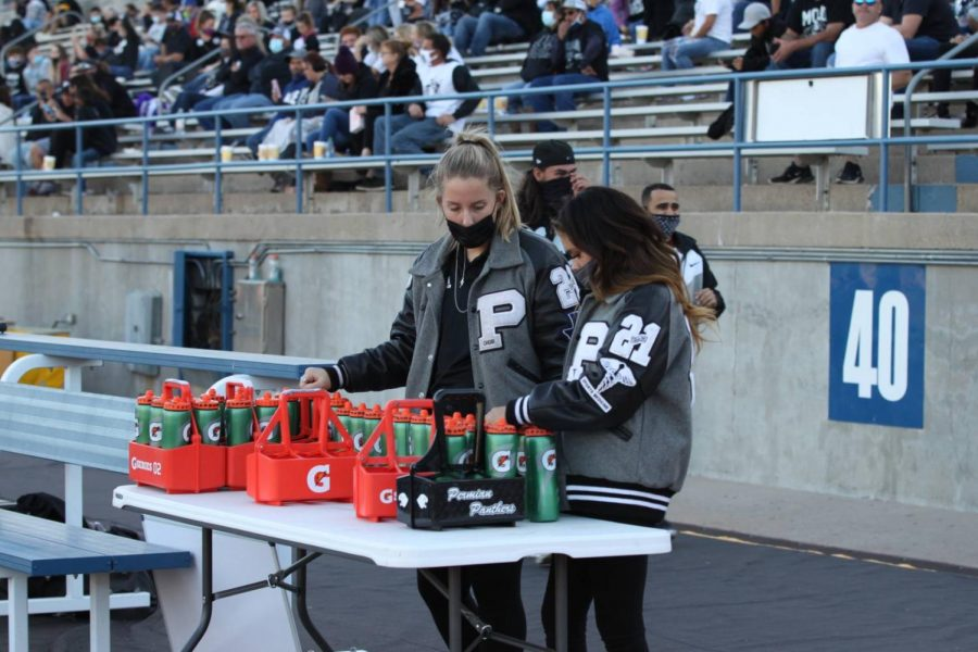 Trainers make sure all of the water bottles are filled before the Homecoming game. Permian would beat Midland Lee 55-44.