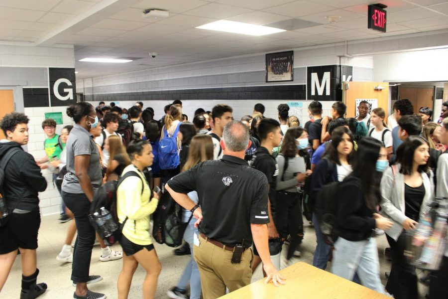 Students crowed in the intersection of M and G hall during passing periods.