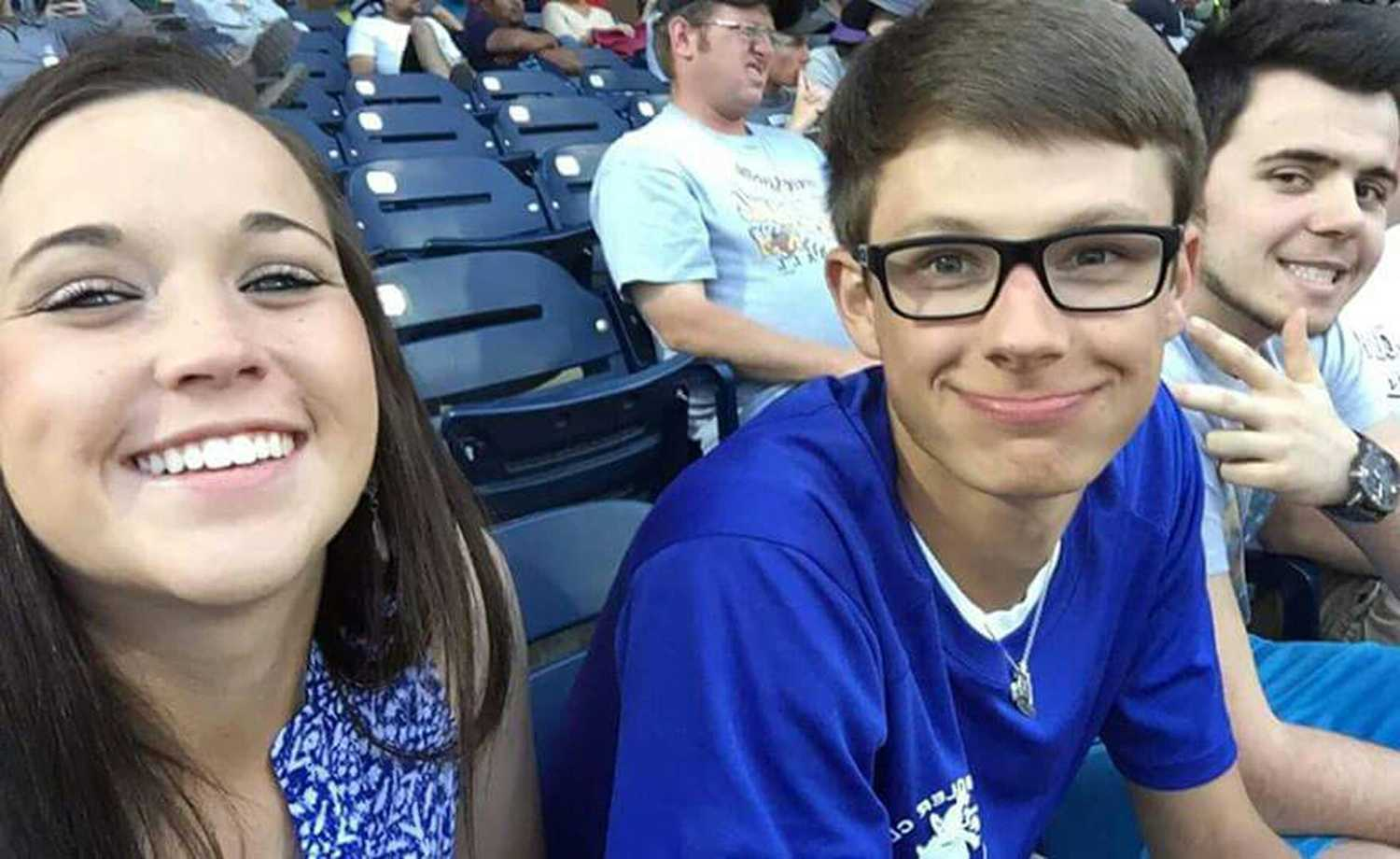 Ryan Tessaro, Courtney Turner and Marcel Zimmer enjoying an evening watching the Midland Rockhounds play.