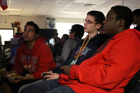 Sophomore Ladarrius Rainwater, freshman Jaren Holdridge, and sophomore Julian Rodriquez play against each other on a PS3.
